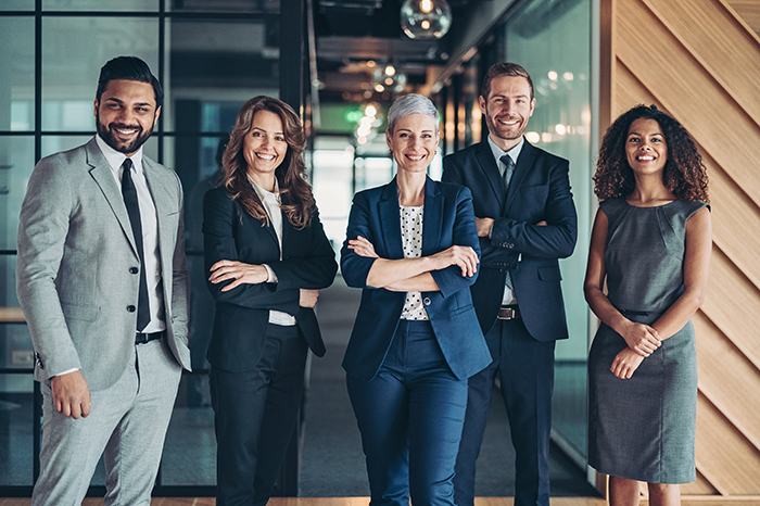 Multi-ethnic group of business persons standing side by side